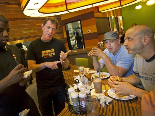 Celebrity Chef Bobby Flay stopped to talk with friends and fellow chefs Michael Symon and Marc Vetri at Flay's Philadelphia restaurant, Bobby's Burger Palace on the 3900 block of Walnut St.