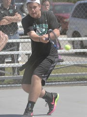 Clear Fork's Noah Brown makes a backhand return in