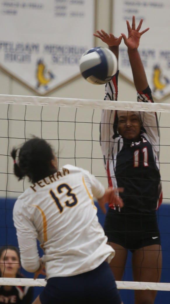 Rye's Cayla Brown (11) blocks Pelham's Nora Tabhaz