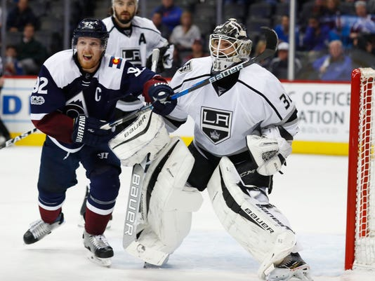 Colorado Avalanche left wing Gabriel Landeskog, left, of Sweden, follows the puck as it flies toward Los Angeles Kings goalie Peter Budaj, of Slovakia, during the third period of an NHL hockey game Tuesday, Feb. 21, 2017, in Denver. The Kings won 2-1. (AP Photo/David Zalubowski)