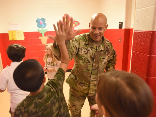 Throughout the year, students from Gilbert Avenue Elementary School in Elmwood Park have been donating to Wounded Warrior and now Maj. Joe Cruz, recently home from Jordan, came to greet the kids and talk to the kids about the military.