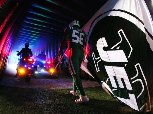 New York Jets linebacker Demario Davis (56) is led