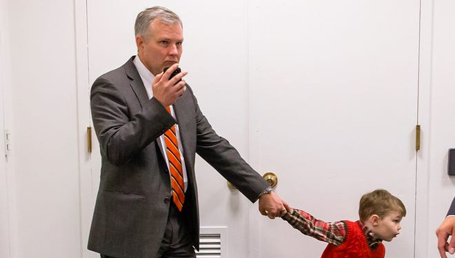 Rep. Tim Griffin, R-Ark., is pulled by his son, John, during the budget impasse that led to the government shutdown.