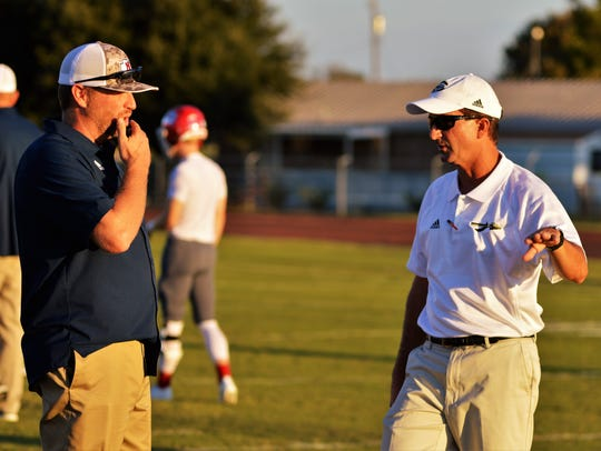 Jim Ned coach Jerod Womack (left) and Comanche's Stephen