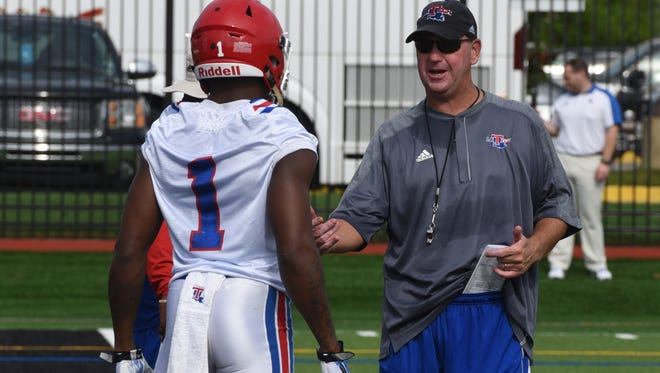 Louisiana Tech coach Skip Holts gives a few words of encouragement to Carlos Henderson while working on kick returns at the annual La. Tech Football Fan Fest.