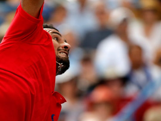 Nick Kyrgios serves in the first set of the men's finals