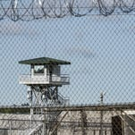 Bloodied bodies stacked in a prison yard: What happens when states slash prison spending