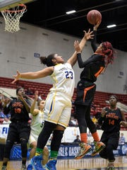 Dunbar's Dekeriya Patterson (15) puts up a shot in front of Cardinal Newman's Milan Morris (23) during a girls basketball game at the FHSAA State Finals, Tuesday, Feb. 17, 2015, in Lakeland, Fla.(Photo/Phelan M. Ebenhack)