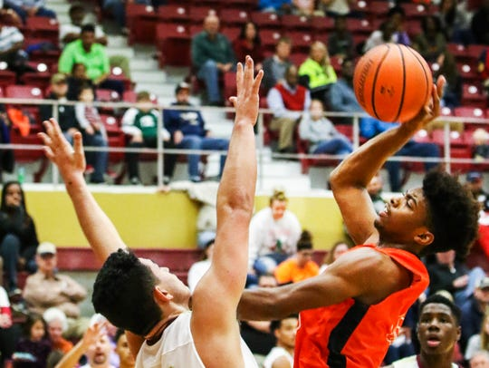Riverdale's Malick McAllister contests a shot by Blackman's