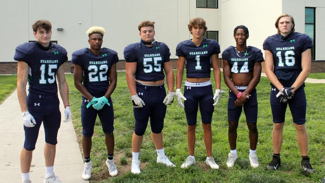 These returning players are expected to lead the St. Michael the Archangel Catholic football team this fall. Pictured, from left to right, are: Noland Boyer; Ellis Edwards, Caleb Berry, John Morris, Sumyl Hayes-Dunnell and Nicholas Haggerty.
