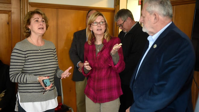 Diane Matynka and Theresa Yantz speak about the effects of drug abuse on families during the open of Lebanon Recovery Center at 701 Chestnut St., Lebanon, on Friday, Dec. 18.