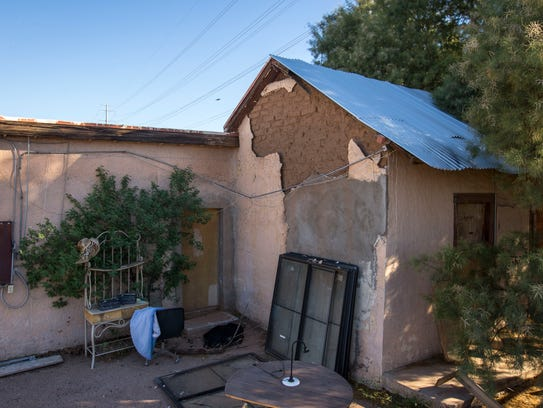 The plaster is falling off the 1860s adobe home Steve