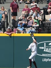 Mississippi State's Rowdey Jordan (4) makes a catch near the left-field wall. Mississippi State played Vanderbilt in an SEC college baseball game on Saturday, March 17, 2018. Photo by Keith Warren