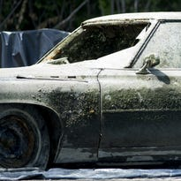 1970s car pulled from mid-Michigan pond has human remains inside