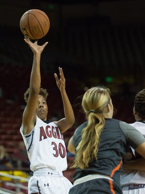 New Mexico State's Gia Pack shoots the ball during the first half of NMSU's game against Pepperdine on Wednesday at the Pan American Center.