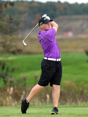 Unioto's Ty Schobelock watches his tee shot on the par-3 eighth hole during the Division II state tournament at NorthStar Golf Club.