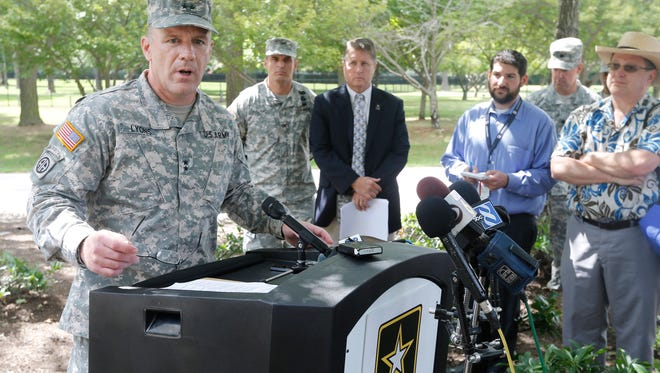 Army Maj. Gen. Stephen Lyons speaks during a news conference at the base in Fort Lee, Va., Monday, Aug. 25, 2014. A female soldier with a gun inside a key building at a Virginia Army base turned the weapon on herself, resulting in a fatal injury. (AP Photo/Steve Helber)