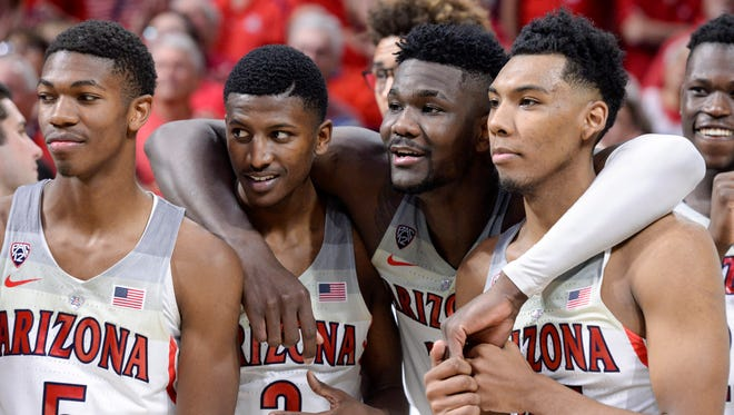 Mar 3, 2018: Arizona Wildcats guard Brandon Randolph (5) guard Dylan Smith (3) forward Deandre Ayton (13) and guard Allonzo Trier (35) (left to right) stand together after defeating the California Golden Bears at McKale Center.