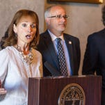 House Speaker Beth Harwell, R-Nashville, speaks during a news conference at the state Capitol on Thursday, June 30, 2016, about a health coverage task force's proposals for Medicaid expansion in Tennessee. From right behind her are Republican Reps. Steve McManus of Memphis and Roger Kane of Knoxville.