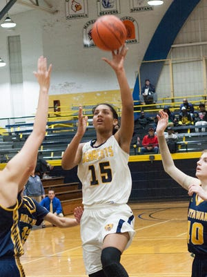 Battle Creek Central freshman Areionna Ware goes to the basket in Bearcats' win over Mattawan. Ware finished with a triple-double in the victory