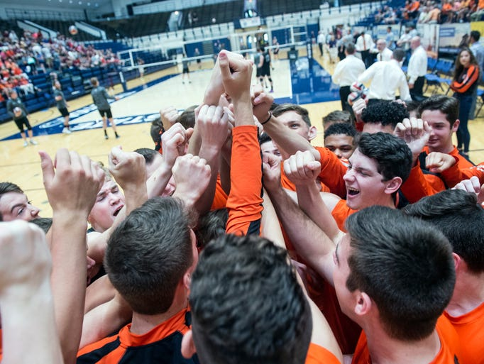 The Northeastern Bobcats break in a huddle prior to