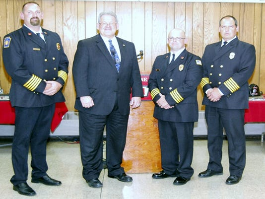 Shown at the Keystone Fire Company's 140th anniversary banquet are, from left, Fire Chief Jason M. â  Jakeâ   Belleman, Fire Commissioner Timothy â  TIMâ   Solobay, Deputy Fire Chief Michael J. â  Wedgeâ   Yiengst, and Assistant Chief John M. Smith. Photo courtesy of Ed Treat