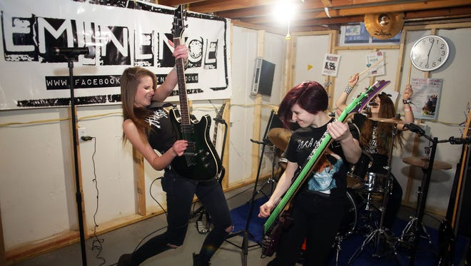 Molly McCarthey (left), Alex Stricker and Caitlin Sweeney (drums) along with Colleen Cline and Kenzie Dupey (not present) make up the rock band Eminence. The five girls are students at five different Fox Valley high schools.