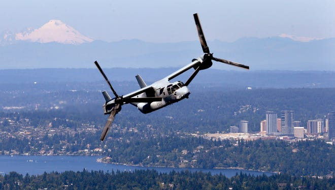 An MV-22B Osprey aircraft flies in view of  downtown Bellevue, Wash.