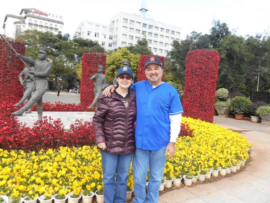 From left, husband and wife Ondrayah Garza and Frank Garza from Lincoln Park are standing at the front entrance to the Flower and Bird market in Kunming, China. The Garza's were in Kunming on business in November 2015.