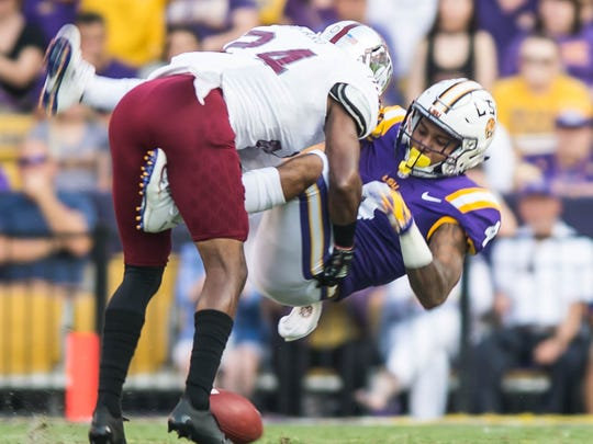 Tigers running back Nick Brossette (4) fumbles the ball for the first offensive play of the game for LSU in a non-conference game against Troy on Saturday night Sept. 30, 2017.