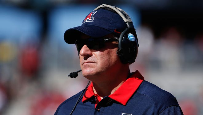 Arizona football coach Rich Rodriguez watches from the sideline against the Washington State on Oct. 24, 2015, in Tucson, Ariz.