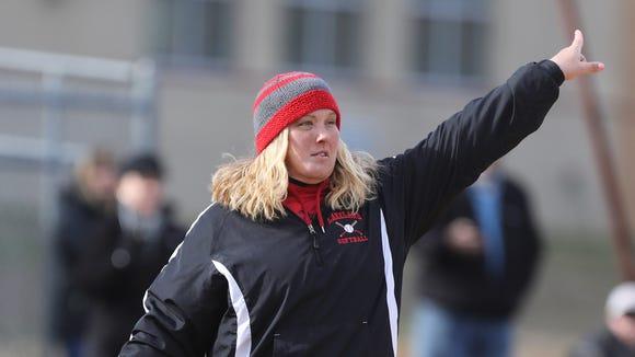 Lakeland coach Laura Junta signals to her runners while