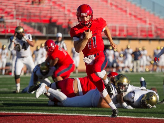 Dixie State University quarterback Trent Darms (11) runs into the end zone for a touchdown against Fort Lewis College at DSU Saturday, September 8, 2018.