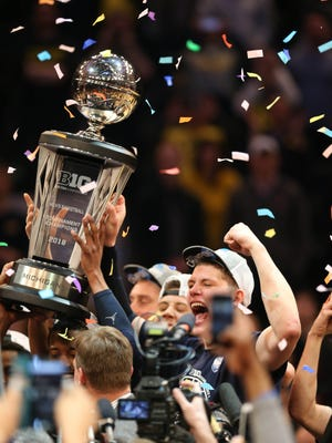 Michigan forward Moritz Wagner celebrates after winning the Big Ten Tournament Championship 75-66 over Purdue on Sunday, March 4, 2018 at Madison Square Garden in New York.