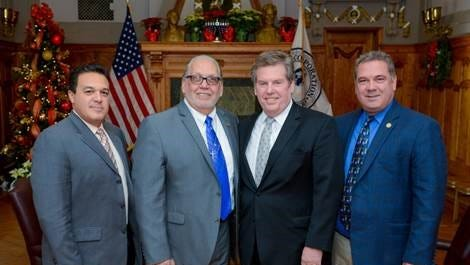 Yonkers Chamber of Commerce president Kevin Cacace, second from the right, was appointed to the Yonkers Board of Education by Mayor Mike Spano, right. Yonkers Schools Superintendent Edwin Quezada is at the left and Board of Education president Steve Lopez is second from the left.