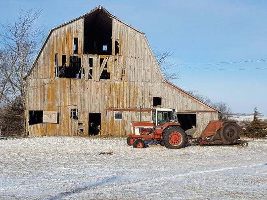 A southern Iowa farmhouse more than a century old that was offered for free on Craigslist -- and captured the fascination of Facebook users -- has found a new home mere miles from its original spot. It will sit alongside this old barn that the owner also plans to rehab.