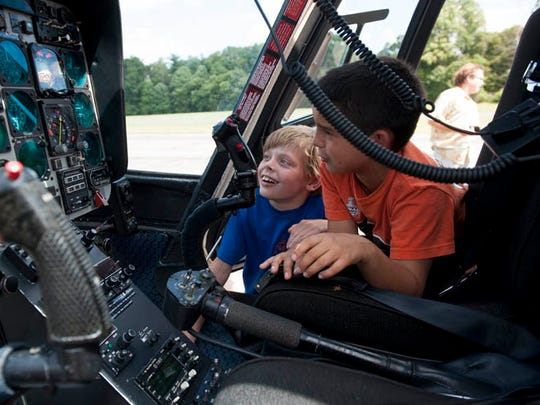 Students from Aerospace4kids, a summer camp focused on flight, flying, airplanes and helicopters, held at the Flying W Airport in Medford, tour the New Jersey State Police helicopter on the last day of camp in this Courier Post file photo.