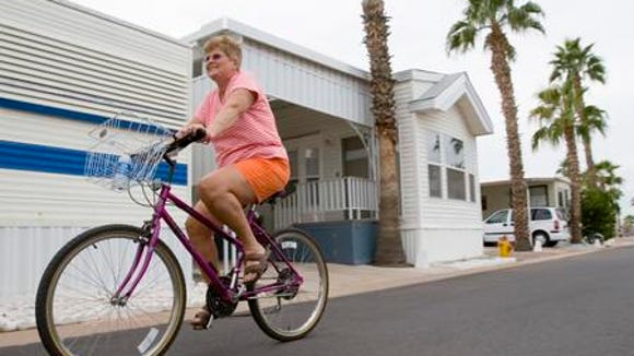In 2005, Barb Harkema, of Grand Rapids, MI, pedaled through the Good Life RV Park in Mesa.
