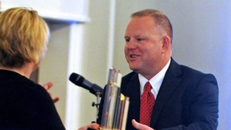 In this file photo, Jody Wade (right), of Jody Wade Enterprises, receives the Small Business Person Award at the 2013 Small Business Awards Banquet. Wade announced this week the closure of all his towing operations.