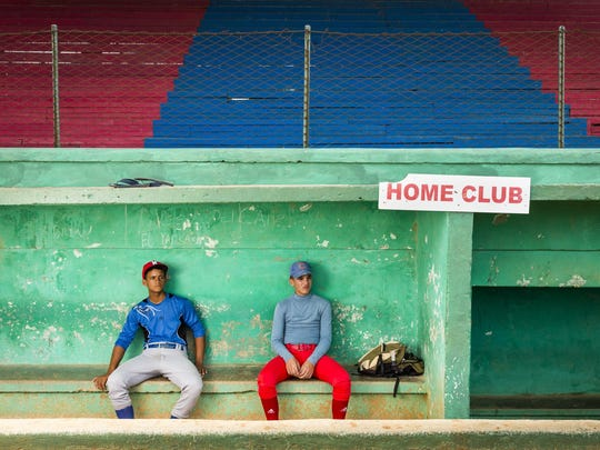 Yusniel Quiala Hernandez, left, and Andy Quesada practice baseball for a national team at Estadio Palmar de Junco in Matanzas, Cuba. The first Cuban official baseball game took place at the stadium in 1874.