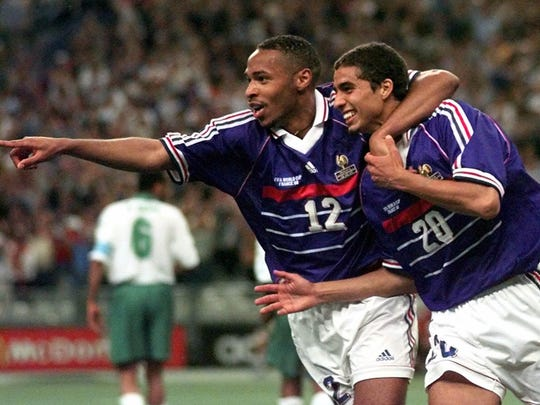France's David Trezeguet, right, celebrates with teammate Thierry Henry.