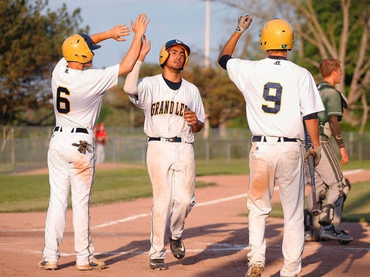 Xavier Farr, center, is a returning starter for reigning CAAC Blue and Diamond Classic champion Grand Ledge.