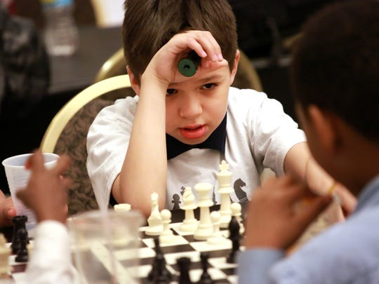 Alberto Jimenez, 9, of Detroit looks up at his opponent at the Detroit City Chess Club  practice at The Detroit Institute of Arts in Detroit on Friday, May 1, 2015.