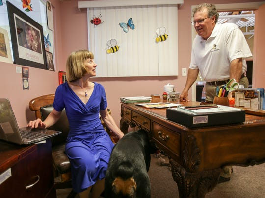 Lada and Evan Mountain, of Waterford Twp work together in the office with their dog Santino at their Fred Astaire dance studio in Bloomfield Hills on Monday, July 18, 2016.