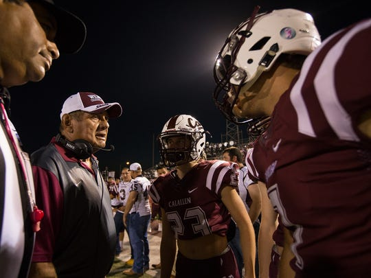 Calallen head coach Phil Danaher talks to the his players before the coin toss prior to the game against Miller at Wildcat stadium, Friday, Oct. 28, 2016.