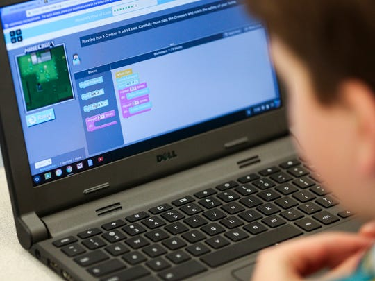A student works on a coding exercise with computer game Minecraft during Whiteaker Middle School's Hour of Code on Friday, Dec. 9, 2016. It was the school's first year participating in the global education movement, which encourages teaching students a one-hour introduction to coding and computer programming.