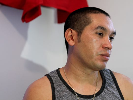 Carlos Larios pauses during an interview in his Long Branch home Thursday, March 30, 2017.  He is a Guatemalan national who illegally entered the U.S. and has lived here for more than a decade.