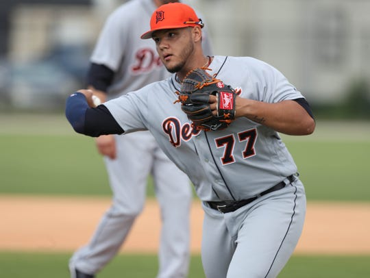 Detroit Tigers pitcher Joe Jimenez goes through drills