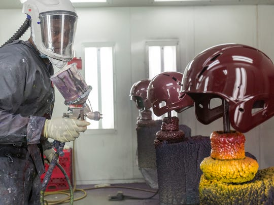 Mike Brown of Oak Park works on three helmets at a time, at the Xenith factory on Tuesday, April, 25, 2017 in Detroit.
