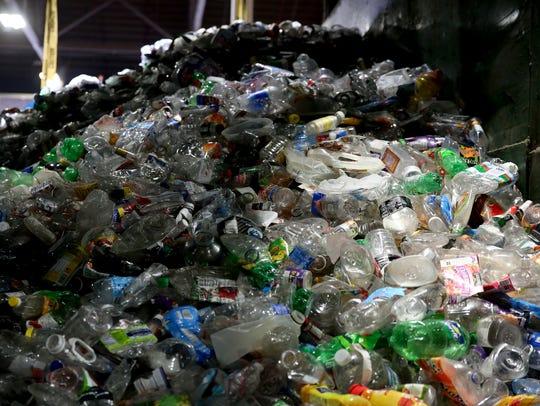 Plastic bottles are sorted at Garten Services in Salem